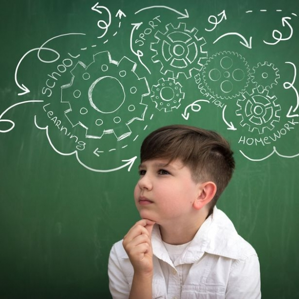 schoolboy thinking about obligations, draw gear mechanism on blackboard